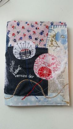 Notebook cover with folkloric dessins, handmade with mixed media. €25