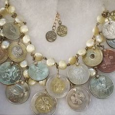 my #globetrotter and her beautiful collection of #travelcoins turned into treasured jOoLs. they're ready for a journey!  send me your coins and watch a #wordly #treasure be born!
