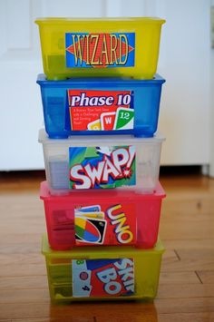 I really like this idea. For those of you with little ones, use your old baby wipe containers to organize card games. Simply paste part of the game box to the outside.