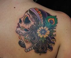 Peacock feather day of the dead shoulder tattoo