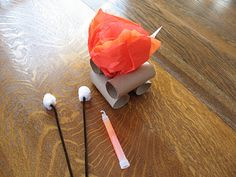 Cute  tissue paper campfire craft for camping theme.  Add a glow stick and turn out the lights to make the fire look even more real!  Cute!!