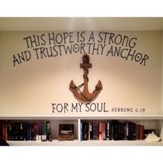 Quote on wall behind bed.
