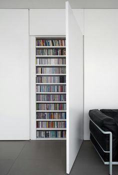 Love this minimal concealed bookcase