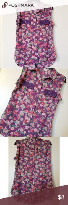 Floral sleeveless blouse - Size: Medium - Brand: Candies - 100% Polyester - Great used condition  *All items come from a smoke free and pet free home*  Feel free to send offers and check out my other items for bundled discounts!! I SHIP DAILY :)  Thank you for viewing!!  Have a wonderful day!! Candie's Tops
