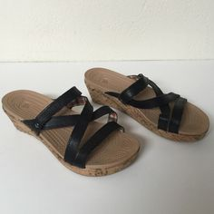 """Fashionable wedge women's crocs sandals Fashionable women's crocs, wedge is 1.5"""" high. Cork material for the wedge, cute plaid detailing on the inside of the black straps. Women's size 7. Worn once, they are very comfortable! crocs Shoes Sandals"""