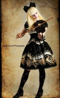 A musically-inclined gothic Lolita. Jobo, these need to be our band uniforms.