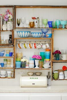 Open cabinets and mismatched vintage dishes- yes please!