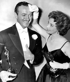 """Susan Hayward wipes the brow of fellow winner,   David Niven won an academy award for best actor for """"Separate Tables"""" and Susan Hayward won for best actress for """"I want to live"""" 1959"""
