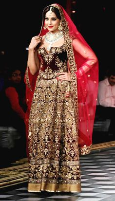 Bipasha Basu walked in a rusty red-velvet lehenga-choli at the India Couture Week 2014 finale.