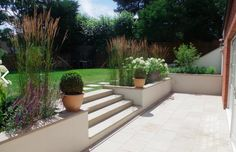 Buff Sawn Sandstone Paving is both hard-wearing and stylish. With a range of matching copings stones, step treads and edgings all avalable off the shelf, this product is extremely versatile and well suited to both traditional and contemporary schemes. Back Garden Design, Modern Garden Design, Backyard Garden Design, Patio Design, Backyard Patio, Backyard Landscaping, Back Garden Ideas, Simple Garden Ideas, Hard Landscaping Ideas
