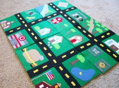 Mini Car Mats.  I love how you can make sections and then the kids can rearrange them.  I think I would put velcro tabs on each side, so they would stay together.