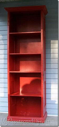A shelving unit made from an old door.