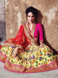 Drezzling digital print lehenga with pastel yellow and hot pink combination.