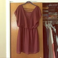 Wine Colored Dress Beautiful and flattering wine colored dress with straps across the back. The first picture is the back of the dress. The waist is elastic. This dress is elegant but comfortable. The brand is City Triangles. City Triangles Dresses Mini
