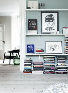 I love how these books are stacked.. Organized chaos at its finest!