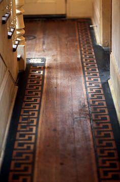 FARMHOUSE – INTERIOR – early american decor inside this vintage farmhouse seems perfect, like this greek key border pattern on the floor.