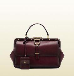 Gucci: lady stirrup top handle  carminio red leather bag