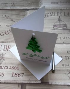 Christmas Card with attached fused glass tree ornament that can be reused as Christmas tree decoration or as sun catcher hung in a window. Card and present in one! Virtually all Christmas cards will end up in the recycling bin, but this card will be remembered year after year by the recipient when they put this decoration on their tree. Supplied with a handmade glass tree made from recycled wine bottles that I flatten carefully in my kiln, the hand-cut with a diamond cutter before…