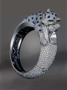 Beguiling Menagerie Cartiers Nature Inspired High Jewelry Panther Prism Watch In White Gold With Sapphires Emeralds Onyx And Diamonds Cat Jewelry, High Jewelry, Animal Jewelry, Luxury Jewelry, Jewelry Accessories, Jewelry Design, Unique Jewelry, Bullet Jewelry, Geek Jewelry