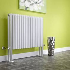 We love the contrast of this white designer radiator against the lime green decor. Lime Green Decor, Lime Green Walls, Horizontal Designer Radiators, Heating Systems, Sweet Home, Home Appliances, House Design, Room, Heating Radiators