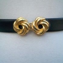 """intage Designer Dotty Smith Black Skinny Faux Leather Adjustable Strap Belt with Gold Metal Tone Celtic Knot Buckle Belt; optional jewelry necklace clasp   Measurements/Size: will fit waist up to 34""""; width 1""""  Designer: Dotty Smith Material: faux leather, metal Condition: Great Vintage Condit..."""