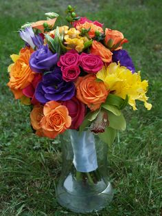 Bridesmaid's Bouquets - orange and pink roses and spray roses, yellow alstroemeria, purple lisianthus, green cymbidium orchids, green hypericum berries, celosia