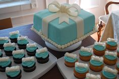 White Cupcakes with Buttercream Frosting and Fondant Bow! Triple Chocolate Fudge Cupcakes with Buttercream Frosting and Fondant . Tiffany Box, Tiffany Blue Cakes, Tiffany Cupcakes, Tiffany Theme, Tiffany Party, Tiffany Wedding, Buttercream Frosting For Cupcakes, Buttercream Wedding Cake, Buttercream Ideas