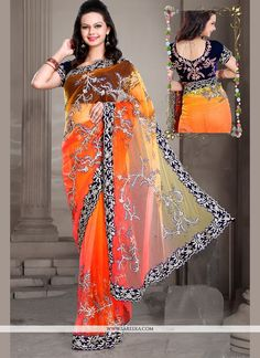 Rich look attire to give your a right choice for any party or function. Real beauty comes out from your dressing style with this orange net designer saree. This lovely attire is looking extra beautifu...
