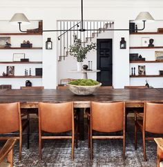 a row of leather dining chairs at a long dining table SP Home Design Architectural Digest, Dining Room Design, Dining Room Furniture, Shelves In Dining Room, Dining Room In Kitchen, Furniture Ideas, Table Shelves, Kitchen Shelves, Dining Room Inspiration