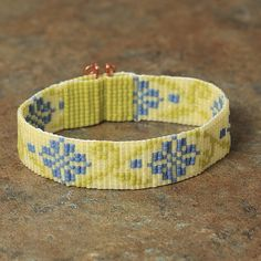 Inspired by a traditional Russian embroidery pattern, this beautiful bracelet was hand made on a loom in Albuquerque, New Mexico. The beads are high