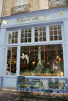 La Fourmi Ailée, in the Latin Quarter near Notre Dame (8 Rue du Fouarre 75005 Paris). It's very cozy, with a fireplace and bookcases on the walls. Great for cold autumn or winter days