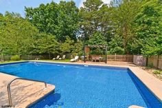 Dive in! This NJ home features a huge swimming pool in the backyard - perfect for hosting parties all summer long!