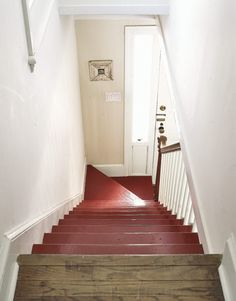 Brighten the path to another floor by painting it a cheerful shade of red.
