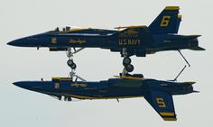 The U.S. Navy Blue Angels perform the Fortus Maneuver at the Quad City Air Show in Davenport, Iowa
