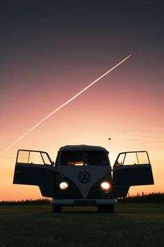 VW van with its doors open and a shooting star in the background.