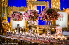 Tall floral table centerpieces. http://www.maharaniweddings.com/gallery/photo/94797