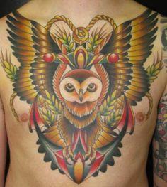 Colorful chest owl tattoo http://blog.tattoodo.com/2014/03/25-beautiful-owl-tattoos/