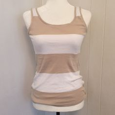 """Ann Taylor Striped Tank Top Measurements: Not yet. Bust:  Waist:  Hips:  Length:   Details: Buttons up the left side. Still has the """"remove before wearing or washing"""" tag attached.  Fabric: 100% cotton.  Follow our store on Facebook, Twitter, Etsy and Instagram: @wingdingpop Ann Taylor Tops Tank Tops"""