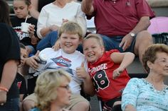 Now these kids look like they're enjoying the game! Check out some of our best high school football fan photos.