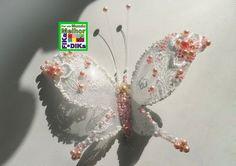 Linda borboleta feita com garrafa pet e renda