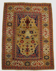 So-called TRANSYLVANIAN rug of the 'double niche' type, 17th century. Woven in northwestern Anatolia (probably the Bergama erea). Wool on wool, 170 x 127.5 cm (Met Museum, N.Y.).