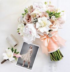 vintage, shabby chic & elegant all in one bouquet!  love this, especially all the stem embellishments!