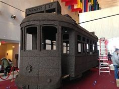 This photo, taken with an iPhone on Feb. 25, 2015, shows an installation created by contemporary artist Nuno Vasa of Lisbon, Portugal, a full-size cable car made entirely of cork _ a major Portuguese export, at the Kennedy Center in Washington.   Picasso's rarely seen ceramics artwork featured in Iberian arts festival at Kennedy Center mysask.com - Travel News