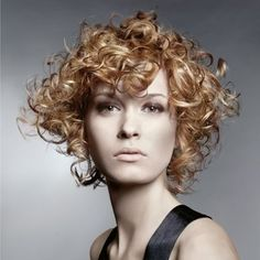 Ultra voluminous medium length curly hairstyle