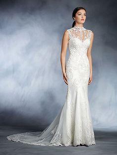 A princess wedding gown with mandarin neck yoke over sweetheart neckline, princess line waist, and flared skirt.