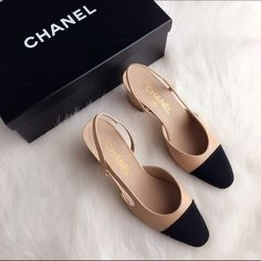 NIB CHANEL Beige Black Classic Slingback 36 SS16 Brand new and 100% authentic. I have been on the waiting list for nearly 5 months for these, but I got both 35.5 and 36 (I normally wear 35.5 but just to be safe I got both pairs). When they finally arrived I decided to keep the 35.5. Sorry but I can't exaggerate enough how scarce they are. They are sold out worldwide! They are the ultimate classic CHANEL designs, beige and black in a short chunky heels, absolutely divine and can never go out…
