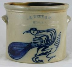 """N. A. WHITE & SON UTICA, N.Y. approximate 1 gallon crock decorated with a rare design of a paddletail looking backwards. Blue at the maker's mark. Professional restoration to a freeze line around the base and a tight line on the front thru the design. 7"""" 1870. sold for $1300 on 9/08."""