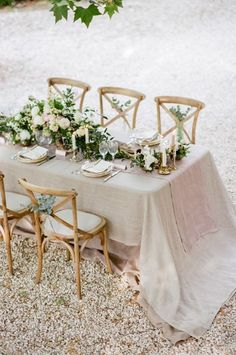 The table for this late spring wedding in Provence was decorated with muted linens, peonies, candles and driftwood. Via Belles & Bubbles.