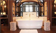 Thomas Urquijo bathroom--mirror detail, soaker tub, garden stools
