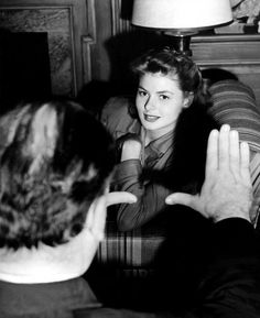 """Director Alfred Hitchcock frames Ingrid Bergman in a still from the set of """"Spellbound"""""""